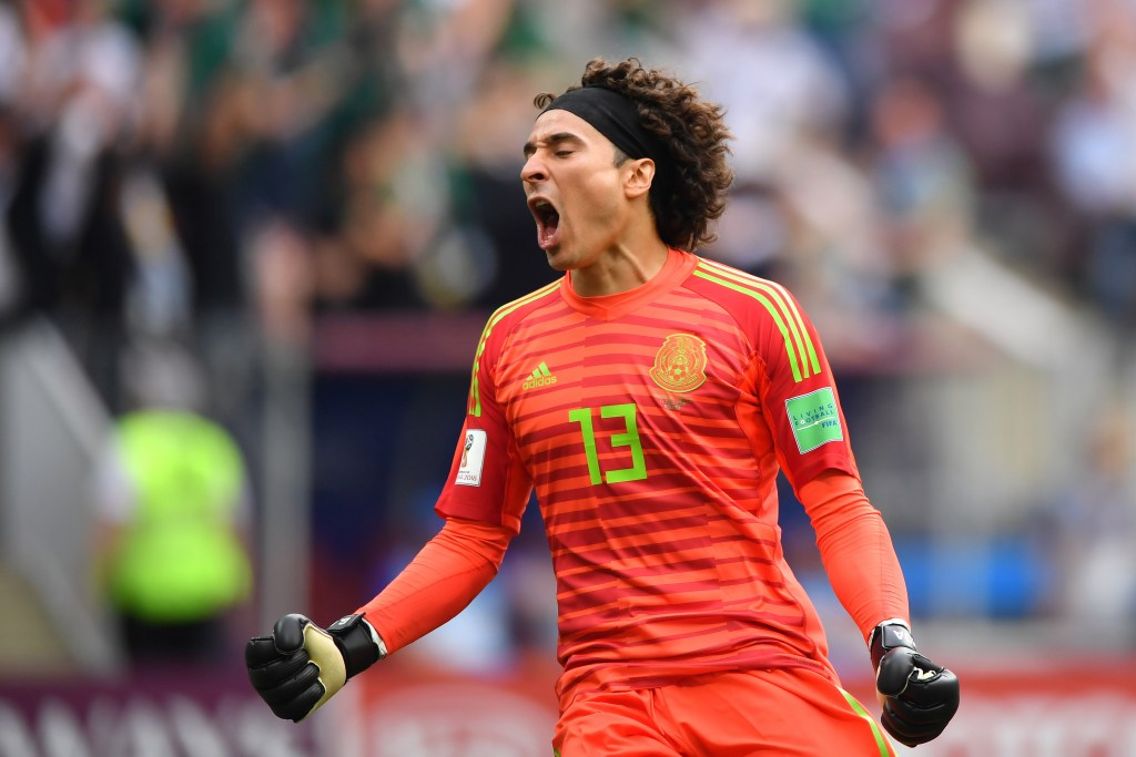 MOSCOW, RUSSIA - JUNE 17: Guillermo Ochoa of Mexico celebrates after his team mate Hirving Lozano scores the first goal during the 2018 FIFA World Cup Russia group F match between Germany and Mexico at Luzhniki Stadium on June 17, 2018 in Moscow, Russia. (Photo by Hector Vivas/Getty Images)